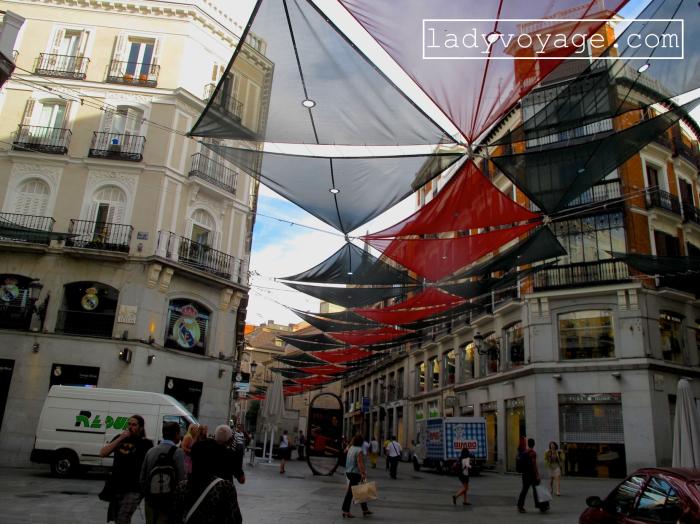 Morning rush in Calle Carmen street, Madrid, Spain