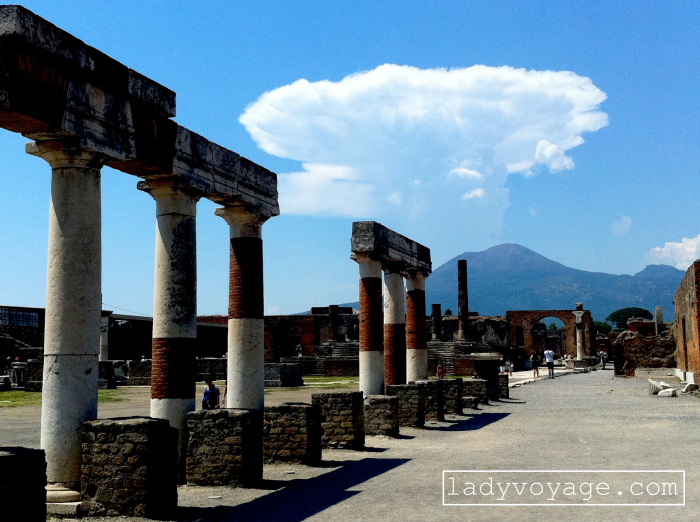 Ruins of ancient Roman city Pompeii and Vesuvius volcano in the back, Italy