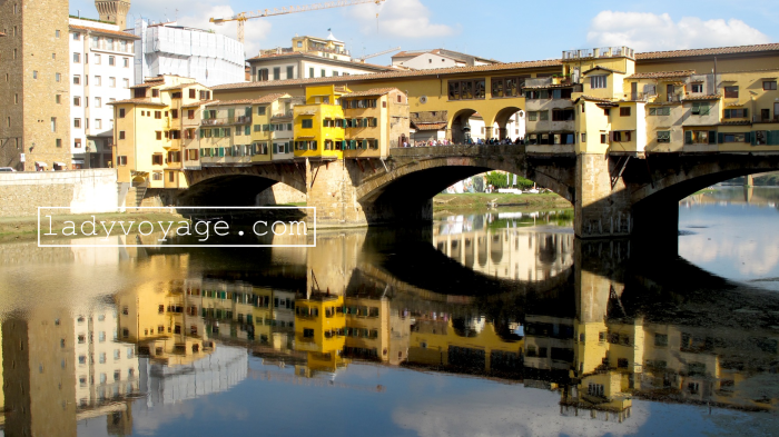 The old bridge Ponte Vecchio and its reflection in Arno river, Florence, Italy