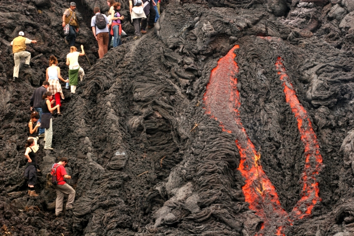 Burning lava tours in Hawaii. Photo borrowed from Bigthink.com